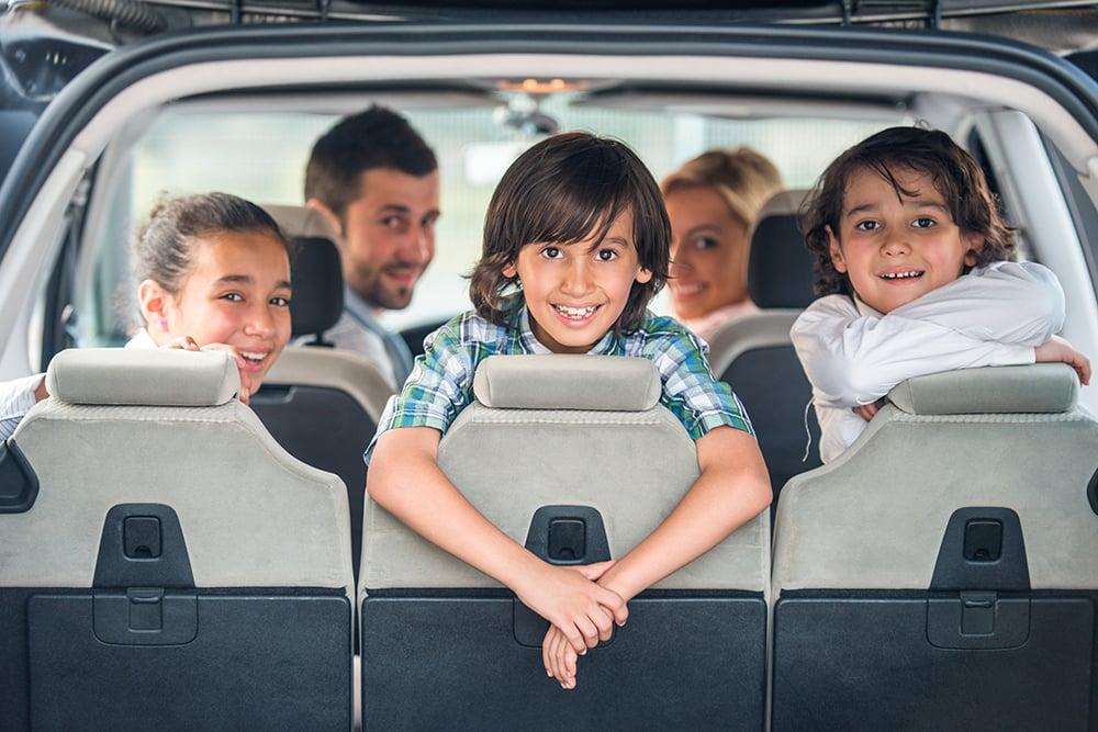 rear view of family in mini van