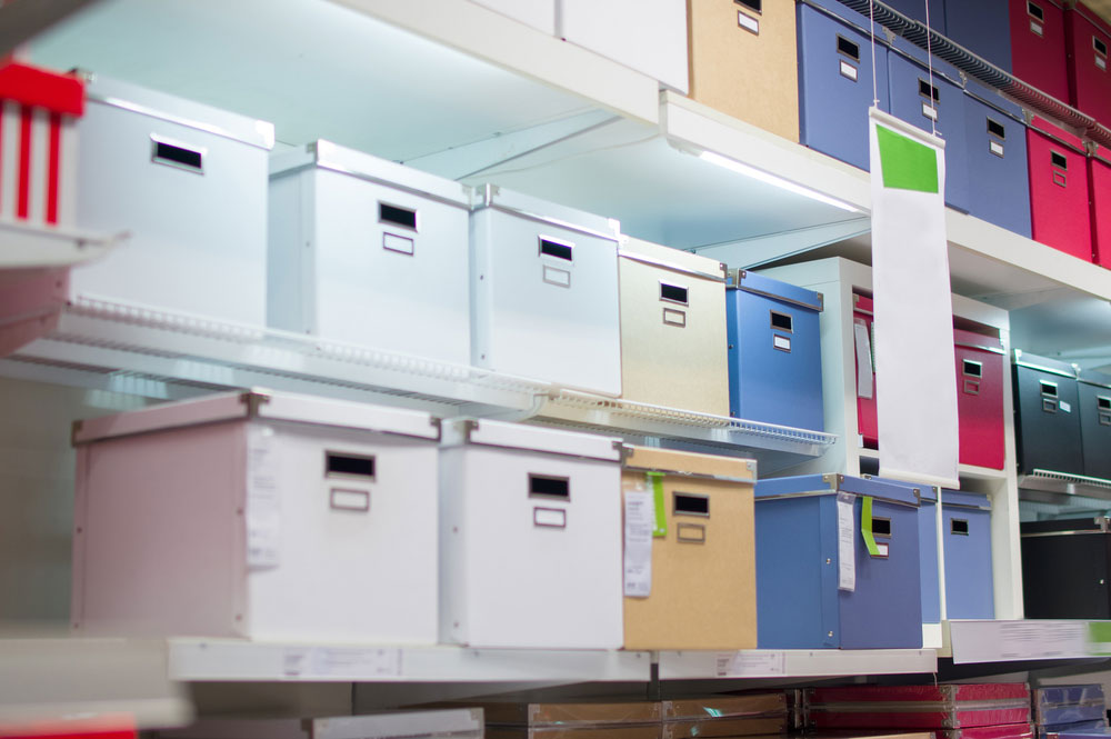 file boxes lined up on shelves