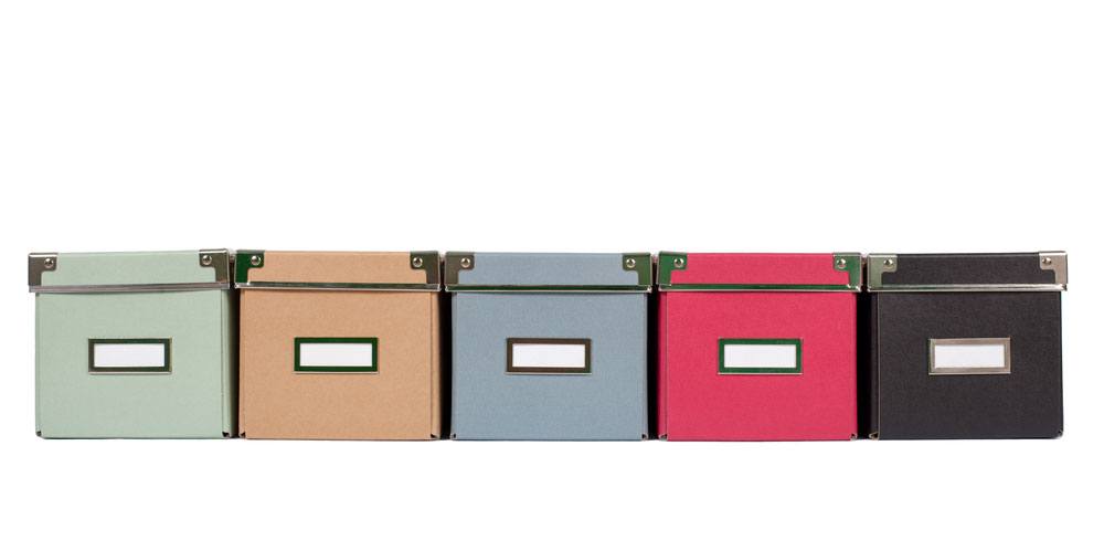 Document storage boxes in different colors lined up on white background