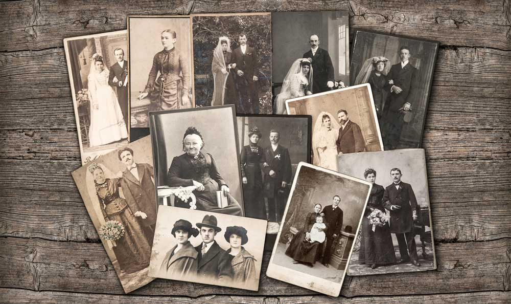 old vintage photos spread across a wooden surface