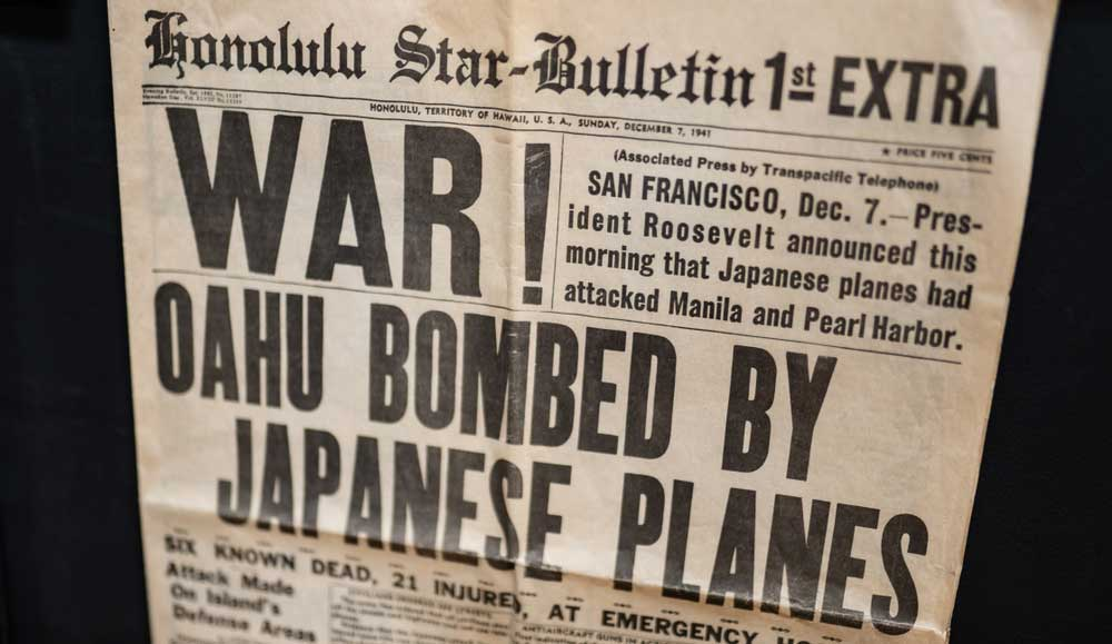 "antique newspaper with headline ""War! Oahu Bombed by Japanese Planes"""