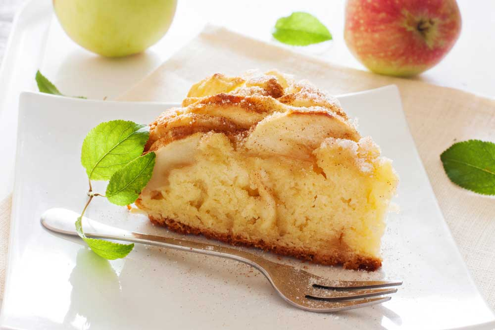 Wedge of apple cake on a white plate