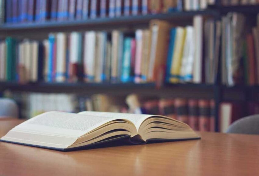 open book on library table