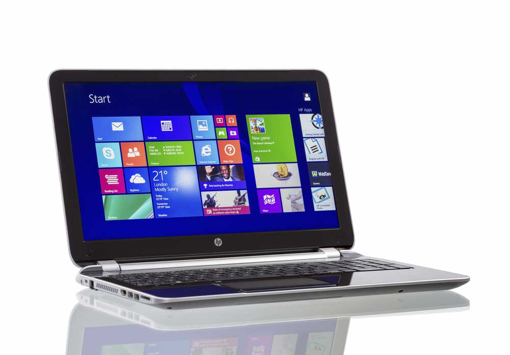 Laptop with Windows operating system on white background.