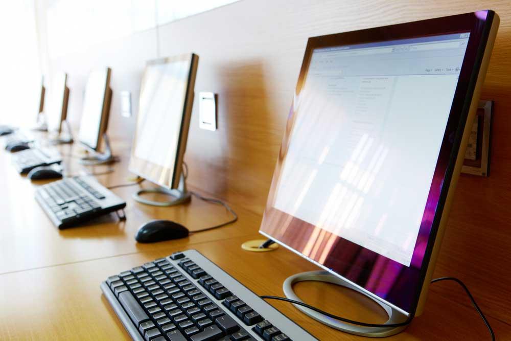 row of library desktop computers