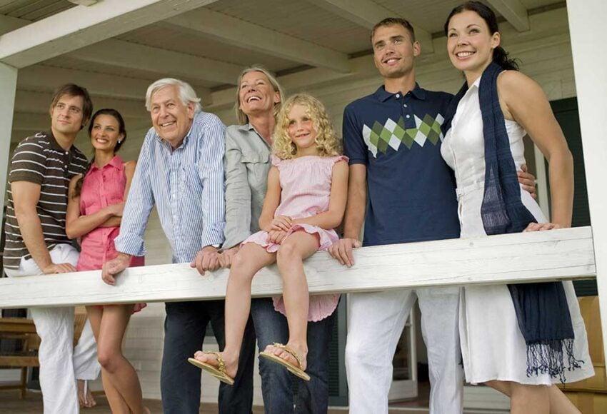 family gathered at porch railing