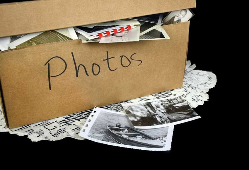 cardboard box with photos spilling out