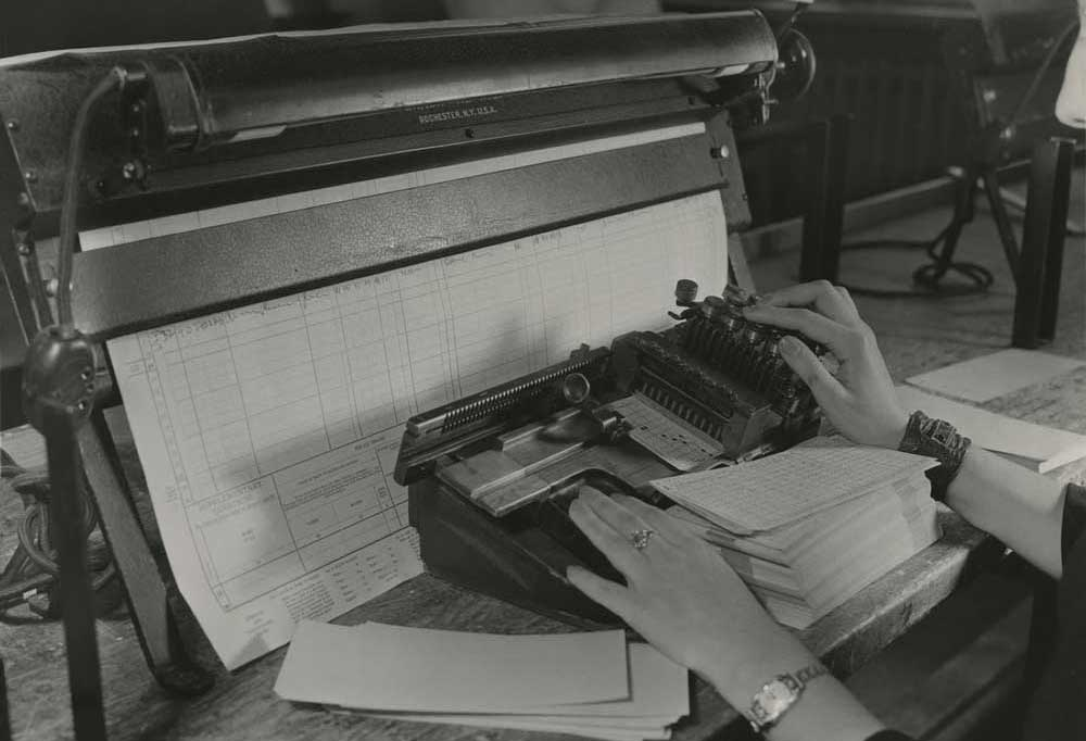 Old photo of census records being recorded