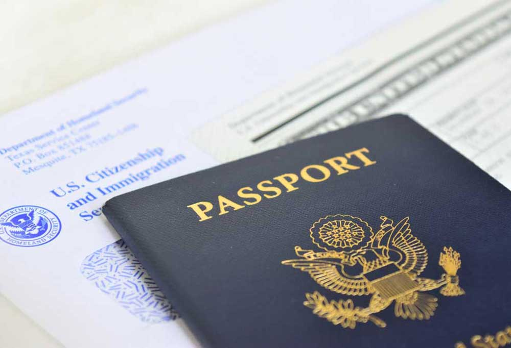 passport laying on top of citizenship papers